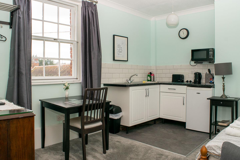 Overnight retreat Ash Suite kitchen and desk area