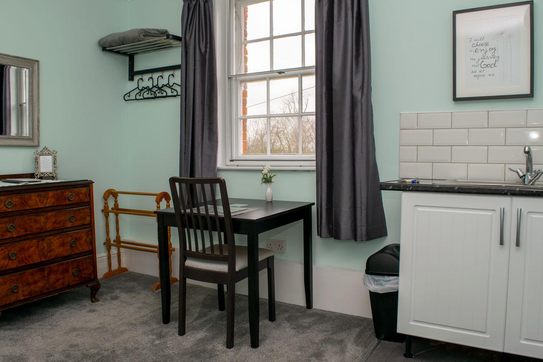 Overnight retreat Ash Suite desk in front of window