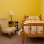 Overnight retreat Piine Suite bedroom comfy armchair