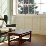 Pine room – Lounge area sofa by window