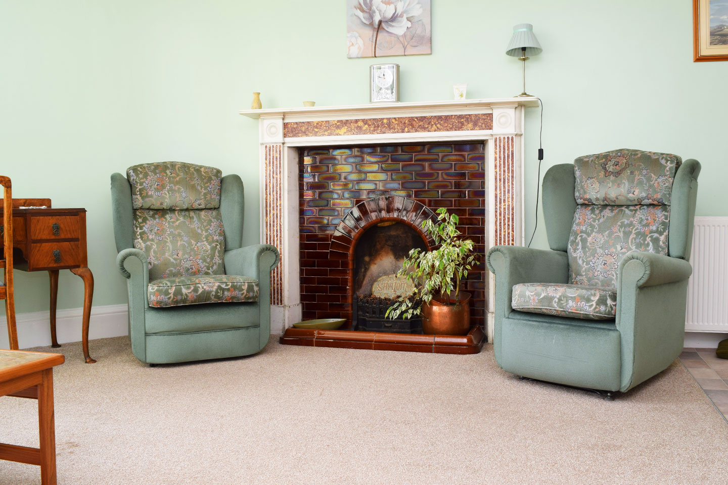 Pine Room - Fireplace and armchairs
